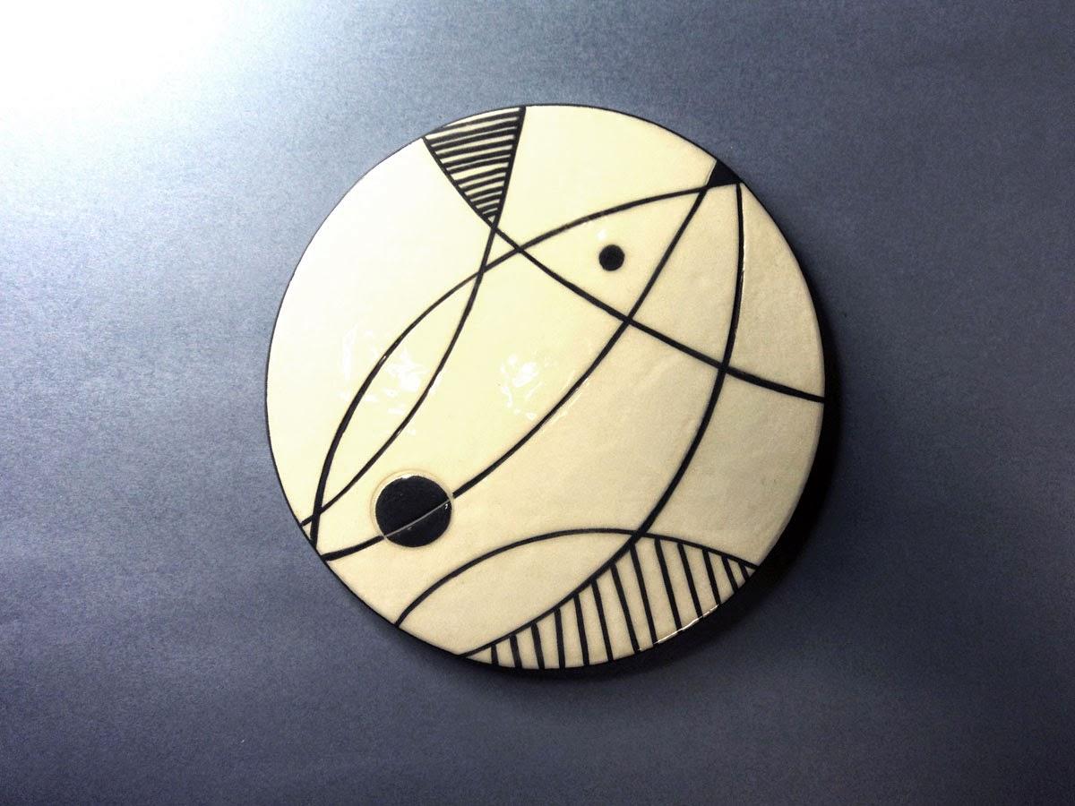 dessous de plat rond graphique en céramique
