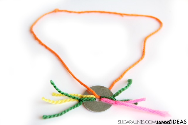 Use yarn and washers to create fun jewelry in this creative process art kids'craft.