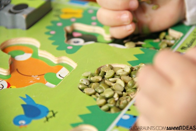 Work on fine motor skills like in-hand manipulation with a wooden letter puzzle.  You can do this with any puzzle and work on things like letter identification, letter formation, numbers, animals, or shapes. Perfect for preschool or toddler activities.