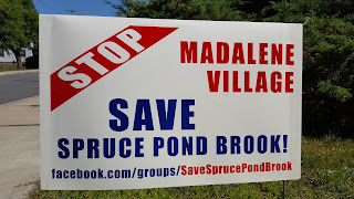 sign in the Peck St, Wachusett St and Cottage St neighborhood of the proposed development