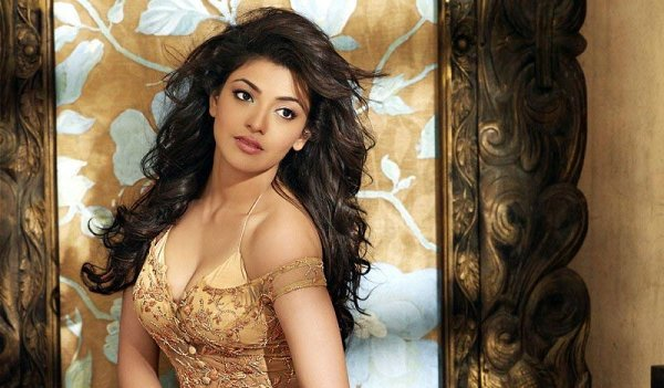 Tollywood Hot Actress Kajal Agarwal Long Hair Photoshoot In Yellow Dress