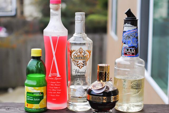 santa's kiss cocktail, whipped vodka, lemon juice, simple syrup, chambord, black raspberry liqueur, x-rated fusion liqueur