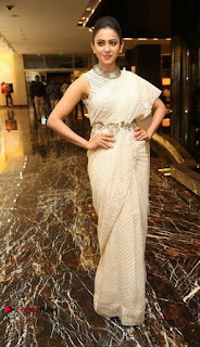 Actress Rakul Preet Singh Stills in White Dress at Winner Pre Release Function  0038.jpg