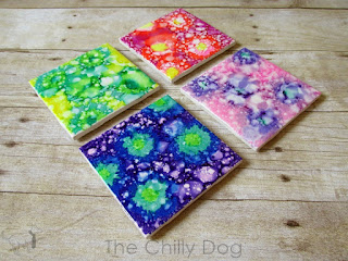 Create colorful coasters with Sharpie markers, rubbing alcohol and plain white tiles.