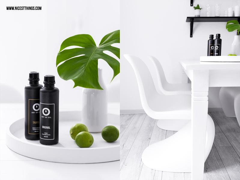Art of Oil Öl schwarze Flaschen auf weissem Tablett mit Monstera Blatt