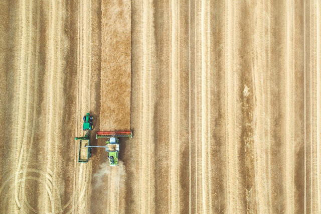 Photo of tractor in field by CloudVisual on Unsplash