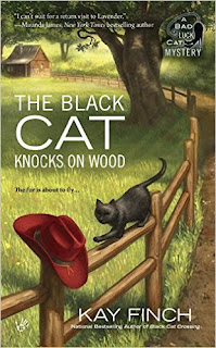 The Black Cat Knocks on Wood: A Bad Luck Cat Mystery book cover