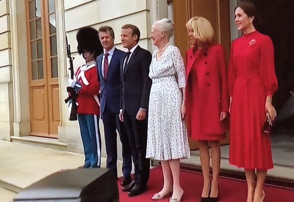 Crown Princess Mary is wearing a Raquel Diniz silk dress. Crown Princess Mette-Marit wore the same dress in 2017