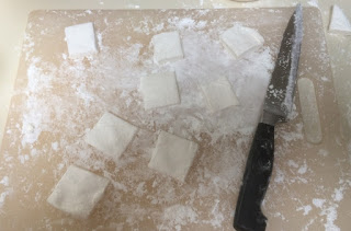 cutting board with knife and homemade vegetarian marshmallow squares