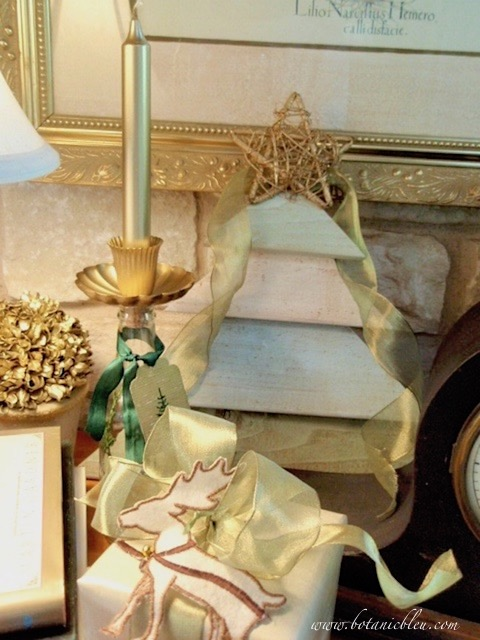 Muted green and gold items create a Christmas vignette for an unusual color scheme