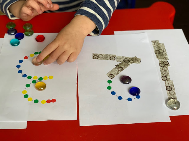 putting the correct number of glass nuggets on the correct number