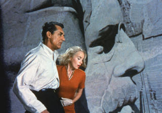 Grant and Saint on Mount Rushmore North by Northwest 1959 movieloversreviews.filminspector.com