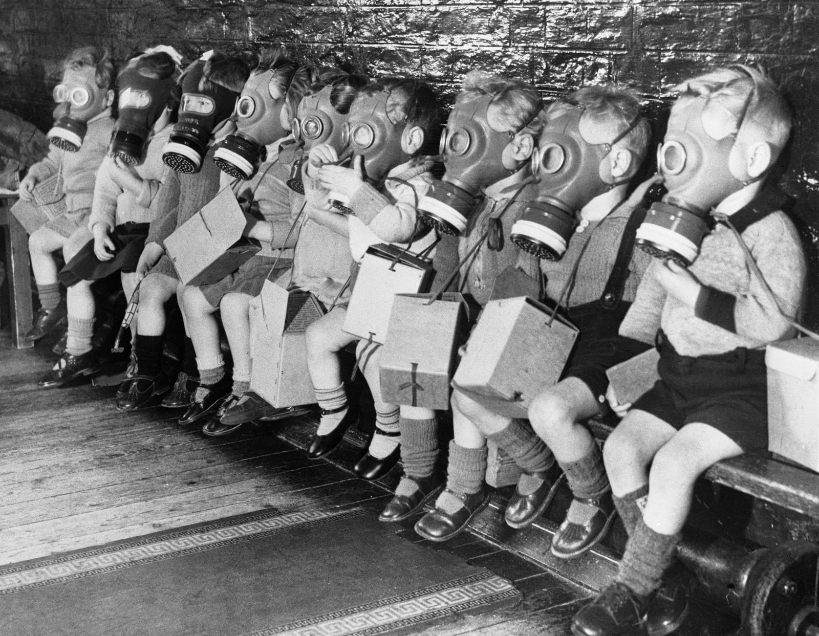 Toddlers On Bench In Gas Masks During Wwii Vintage Everyday