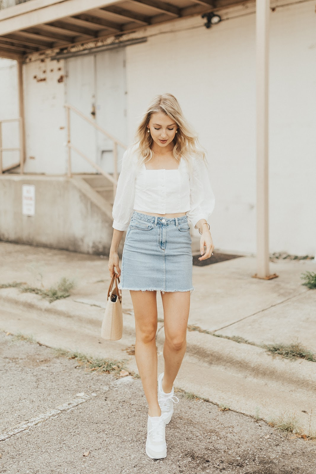 dress down a top with a denim skirt & sneakers
