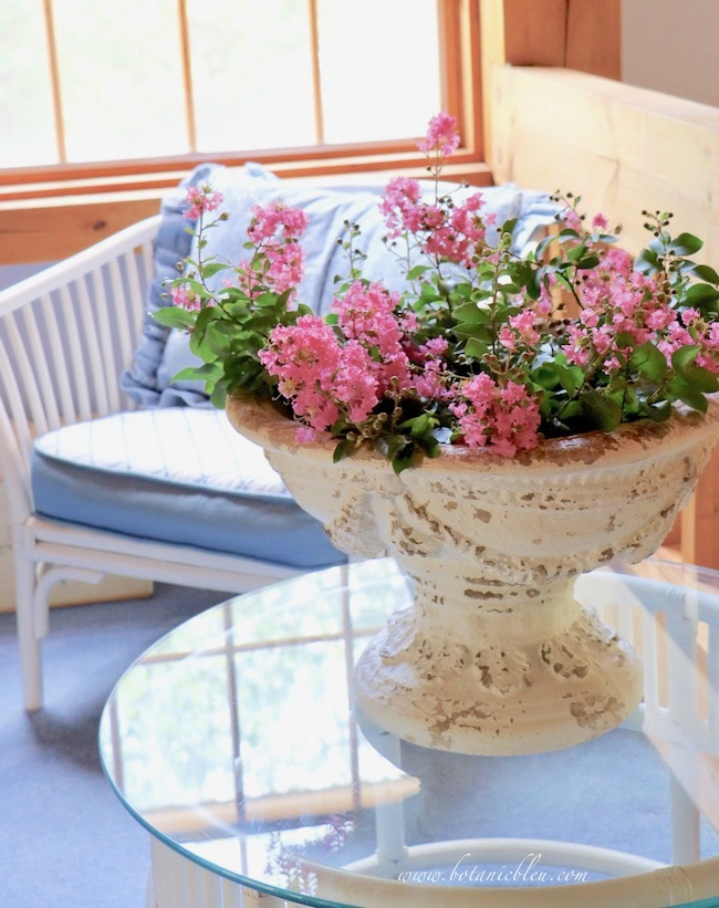 Include pink crepe myrtle flowers in a white urn to make French Country decor reflect a life filled with joy.