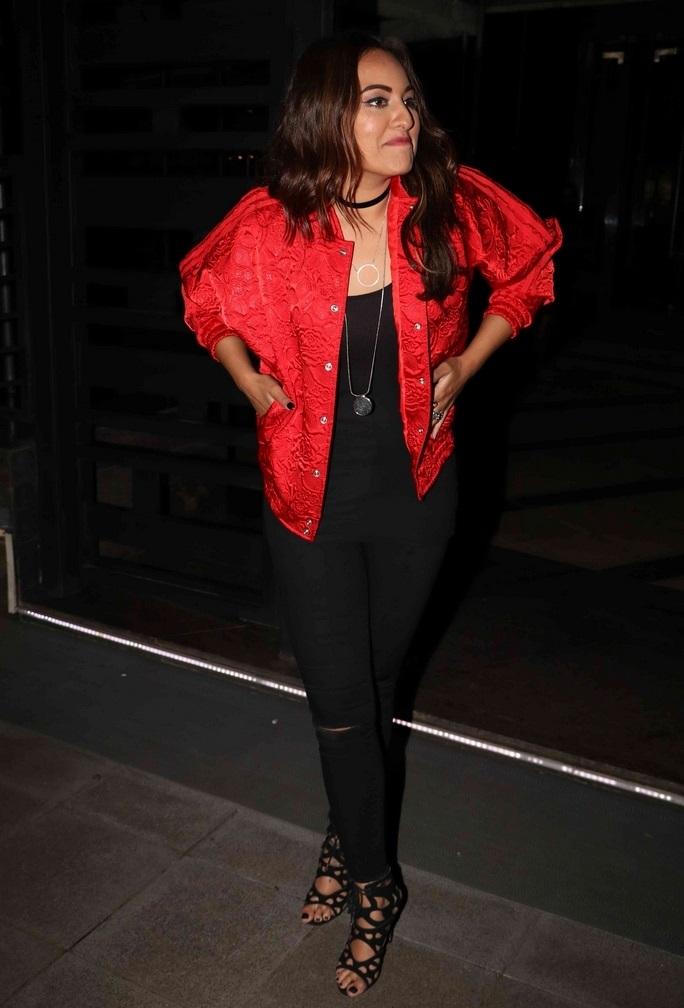 Hot Indian Girl Sonakshi Sinha Smiling Face Stills In Red Jacket Black Jeans