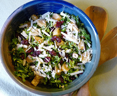 Brussels Sprouts Salad with Dried Cranberries Hazelnuts and Cheese