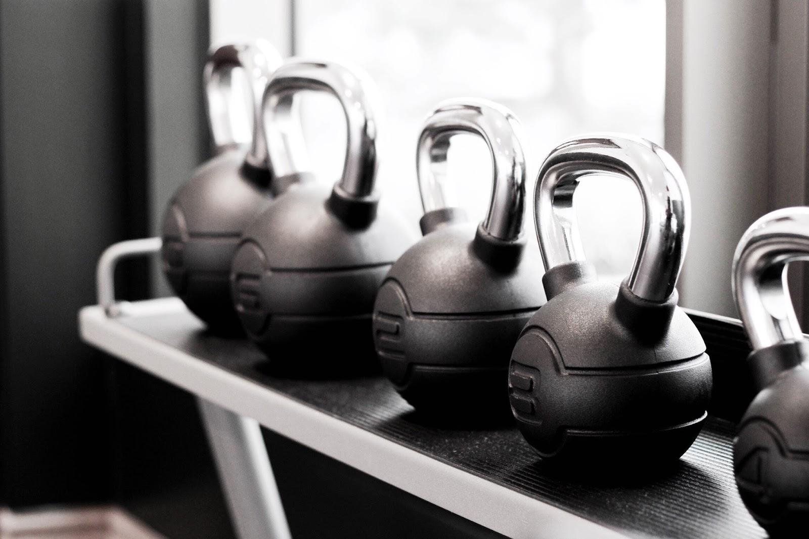 Line of kettlebells at hotel gym