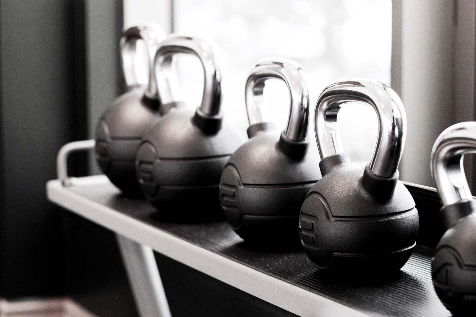 Line of kettlebells at hotel gym