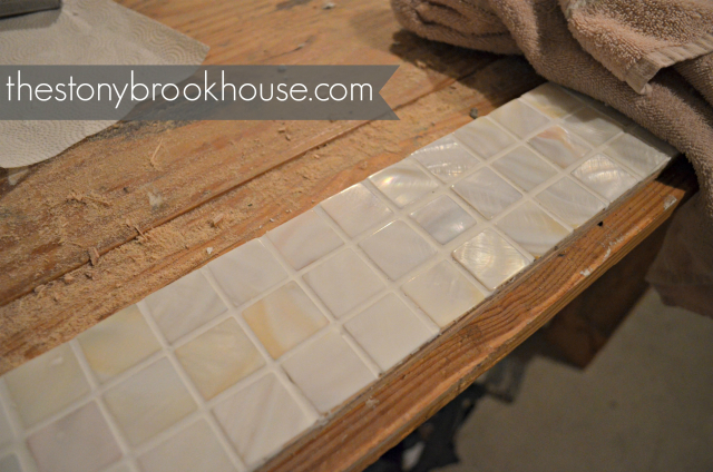 Grouted and buffed tile on mirror frame