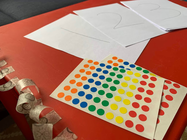 The basic exercise for number recognition set up ready to go with washi tape, sticky dots and paper with numbers written on