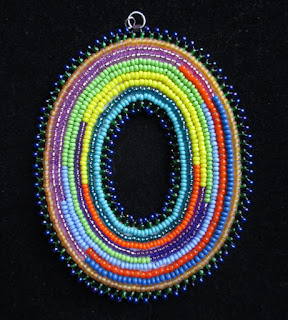 https://www.etsy.com/listing/271715330/ellipse-bead-embroidered-pendant
