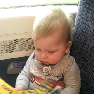 baby on train, cute baby, blonde haired boy