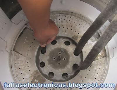 como quitar canasta de lavadora