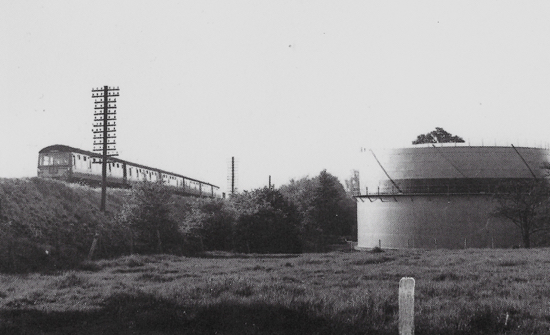Photograph of Gasometer Bulls Lane 1966 Train travelling from Welwyn Garden City