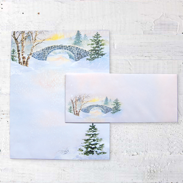 Winter Morn Letter Paper and matching envelope from Idea Art on top of white wood background.