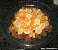half the deep dark secret cake, covered in bananas and satsuma segments