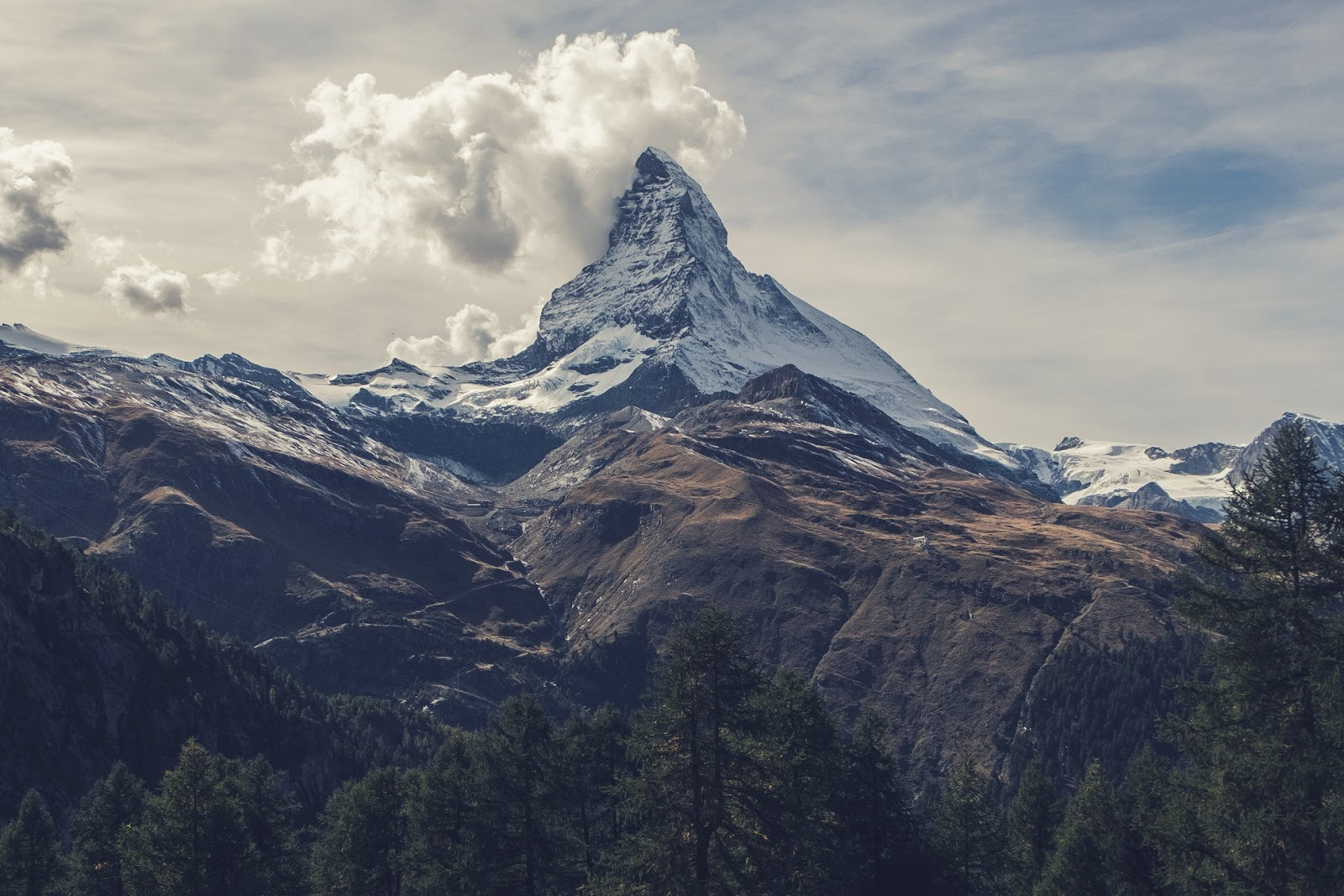snowy mountain and clouds