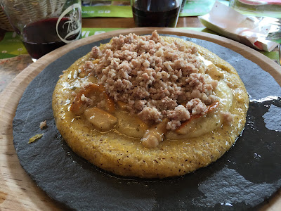 Polenta with cheese, mushrooms, and cheese at Rifugio Laghi Gemelli