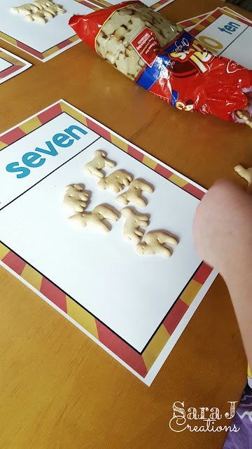 Counting out animal crackers to practice 1 to 1 match for numbers 1-10.