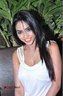 Actress Model Pooja Sri Stills in White Short Dress at F Club pre soft Launch  0072.JPG