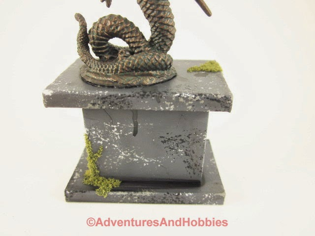 Miniature snake goddess of war statue in 25-28mm scale - close-up of base - rear.