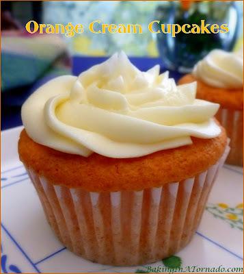 Orange Cream Cupcakes are light and fluffy orange and French vanilla cream flavored cakes frosted with a creamy orange frosting. | Recipe developed by www.BakingInATornado.com | #recipe #dessert