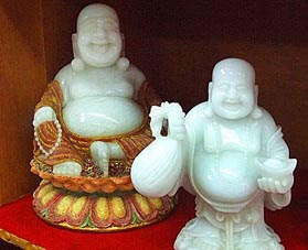 White Jade Buddha Sculpture with Ruby and Gold Dust