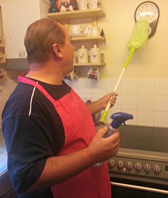 Man with Feather Duster and Pink Apron