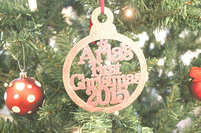 pink glittery personalised baby's first christmas tree decoration