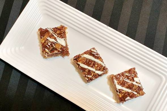 pecan pie bar cookies drizzled with cholate
