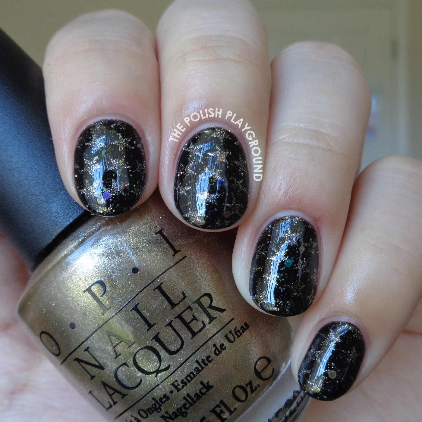 Black Glittery Galaxy with Gold Stars Stamping Nail Art