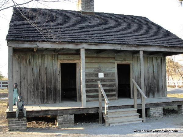 slave cabin with child sculptures at Whitney Plantation in Wallace, Louisiana