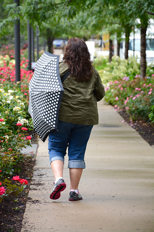 mom walking with umbrella