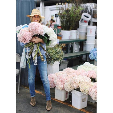 Rachel Ashwell holding bouquets of flowers at flower market