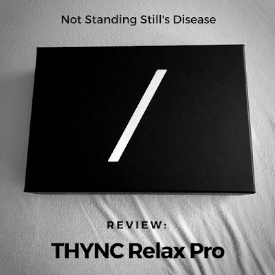 "a photo of the THYNC box (black rectangular box with a white slash in the middle) against a light blue sheet; photo has been darkened and colors other than B&W aren't distinguishable; black text at top middle ""Not Standing Still's Disease"" and at bottom middle ""Review: THYNC Relax Pro"""