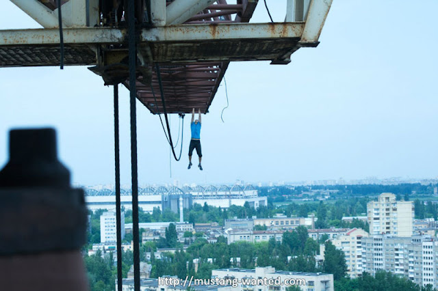 Man hanging from the crane