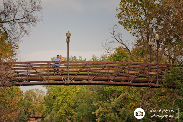 photography of a couple on a bridge in colorado for their engagement session