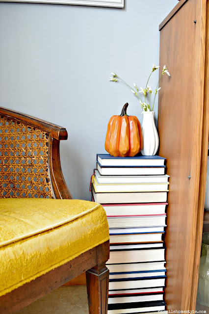 DIY side table made from a stack of thrift store books