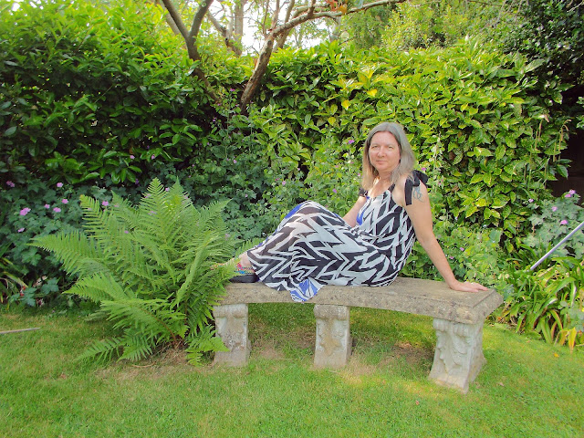 zig zag dress  from JD Williams website modelled in a green and leafy garden